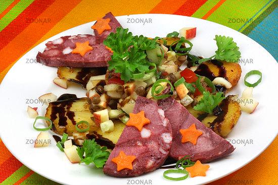 Sterneküche mit Linsen und Rotwurst © Liz Collet